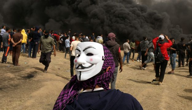A demonstrator wearing a mask is seen during clashes with Israeli troops at a protest at the Israel-Gaza border,  April 20, 2018.