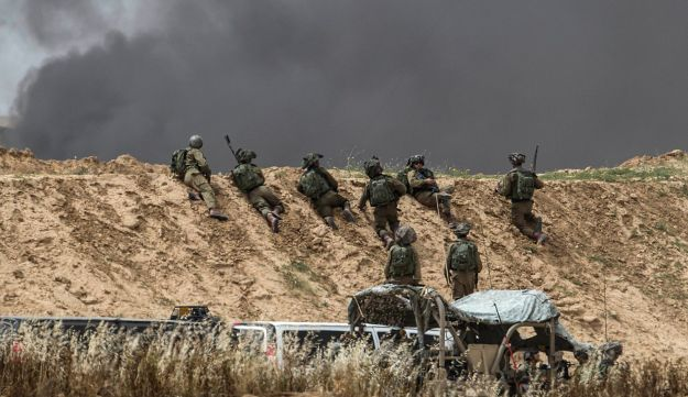 Israeli soldiers are seen during protests along Israel Gaza border, Friday, April 20, 2018.