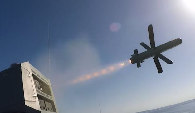 A still from the music video shows the Typhoon weapon system firing Spike missiles from an Azeri navy ship.