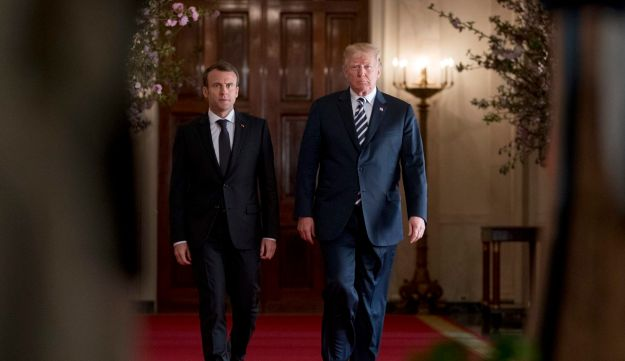 President Donald Trump and French President Emmanuel Macron arrives for a news conference in the East Room of the White House in Washington, Tuesday, April 24, 2018.