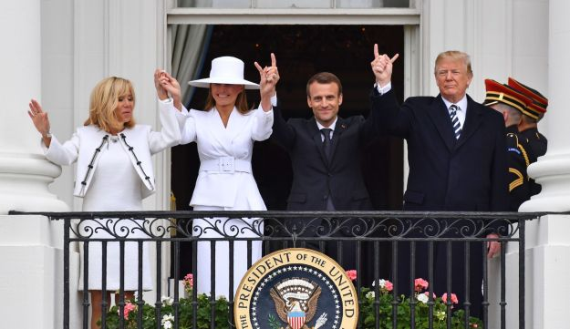 US President Donald Trump (R), French President Emmanuel Macron (2nd R), US First Lady Melania Trump (2nd L) and French First Lady Brigitte Macron are seen on the balcony at the White House in Washington, DC, on April 24, 2018.