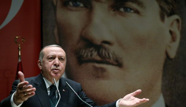 "Turkish President Recep Tayyip Erdogan speaking during a meeting in Ankara, Turkey, March 30, 2018. Turkish founding father (and ""Benevolent dictator"") Mustafa Kemal Ataturk looms large in the background."