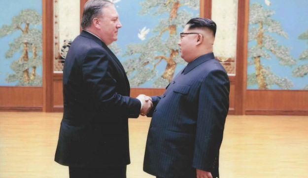 Pompeo shaking hands with Kim Jong Un in North Korea.