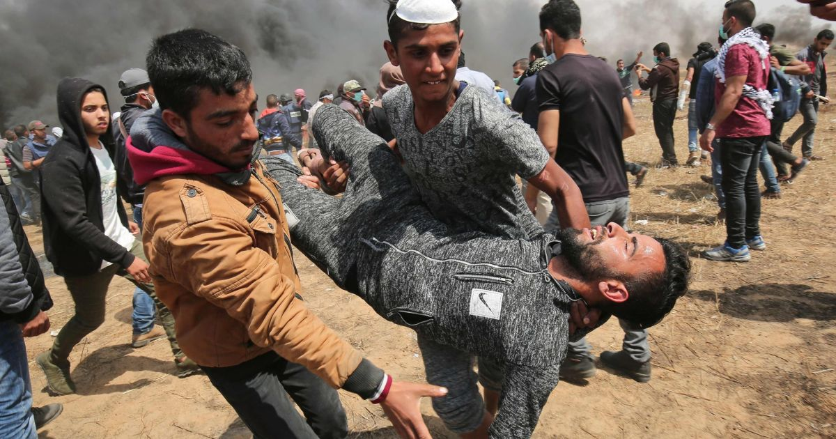 Gaza protests: 'Three killed, 174 wounded' as Palestinians march on border for fifth week