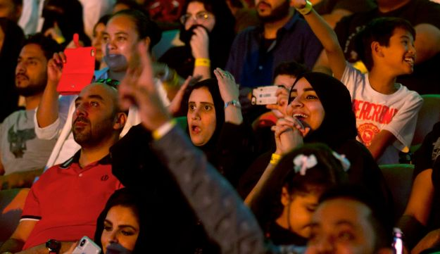 "Fans react as they watch the World Wrestling Entertainment Inc.'s ""Greatest Royal Rumble"" event in Jiddah, Saudi Arabia, Friday, April 27, 2018. A previous WWE event held in the ultraconservative kingdom in 2014 was for men only. But Friday night's event in Jiddah included both women and children in attendance."