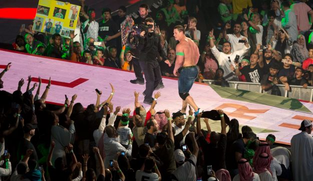 "World Wrestling Entertainment star John Cena is greeted by fans during the ""Greatest Royal Rumble"" event in Jiddah, Saudi Arabia, Friday, April 27, 2018. A previous WWE event held in the ultraconservative kingdom in 2014 was for men only. But Friday night's event in Jiddah included both women and children in attendance."