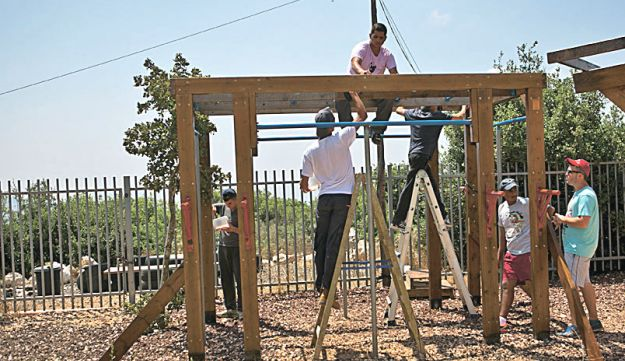 FILE PHOTO: Mechina Tzur Shalem building shelter as an activity during their pre-army program, 2015.