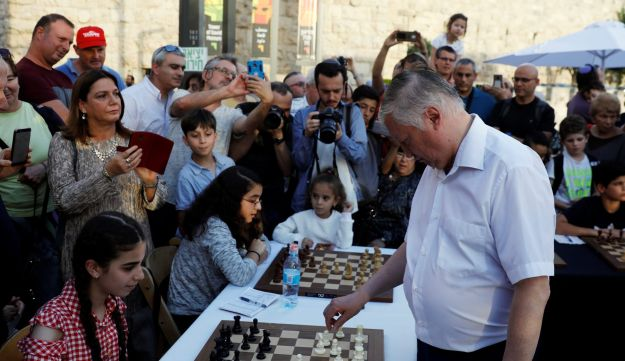 Former Russian chess world champion Anatoly Karpov plays simultaneous matches against tens of Israeli players during an event marking Israel's 70th anniversary at Jerusalem's Old City's Jaffa Gate, April 30, 2018.