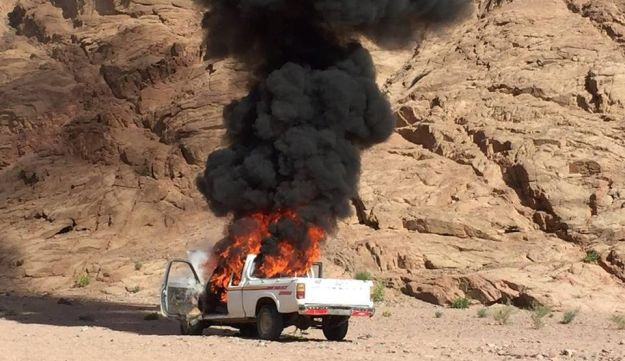 A burning vehicle is seen during a major assault against militants by Egyptian Army's soldiers in the troubled northern part of the Sinai peninsula in Al Arish, Egypt.