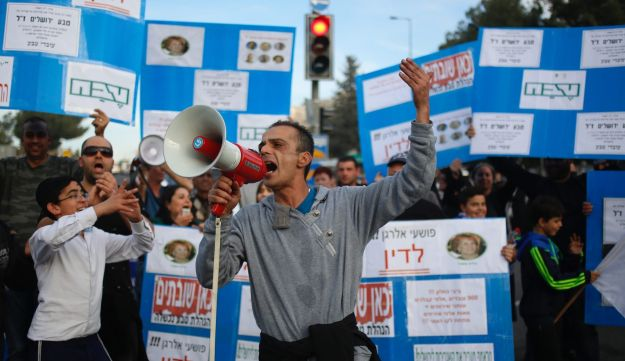 Teva workers protest outside the Teva Pharmaceutical Industries factory as the block a main road in Jerusalem, 2017