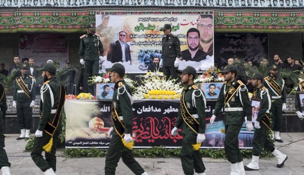 Iranian soldiers walk past coffins of two member of Iranian Revolutionary Guards who were killed in Syria, during their funeral in Tehran October 28, 2015
