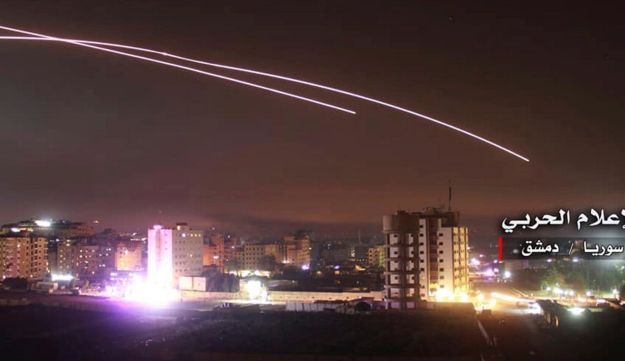 This photo, provided by the government-controlled Syrian Central Military Media, shows missiles rising into the sky as Israeli missiles hit air defense position in Damascus, May 10, 2018.