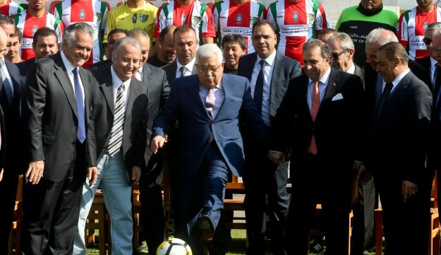 Palestinian President Mahmoud Abbas kicks a ball at La Cisterna Municipal Stadium during a visit to soccer club Deportivo Palestino. Santiago, Chile, May 10, 2018