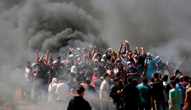 Palestinians protest near the Gaza-Israel border, July 14, 0218.