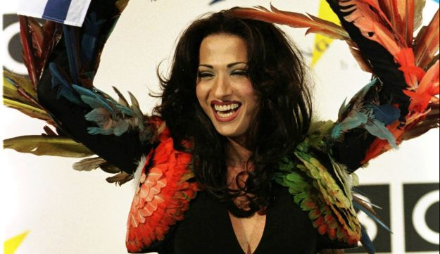 Dana International celebrates her Eurovision victory in 1998. Chicken wings - courtesy of Jean Paul Gaultier.