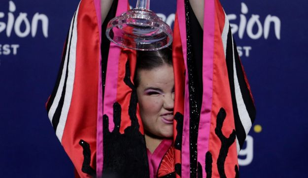 Israel's Netta poses with the trophy during the news conference after winning the Grand Final of Eurovision Song Contest 2018.