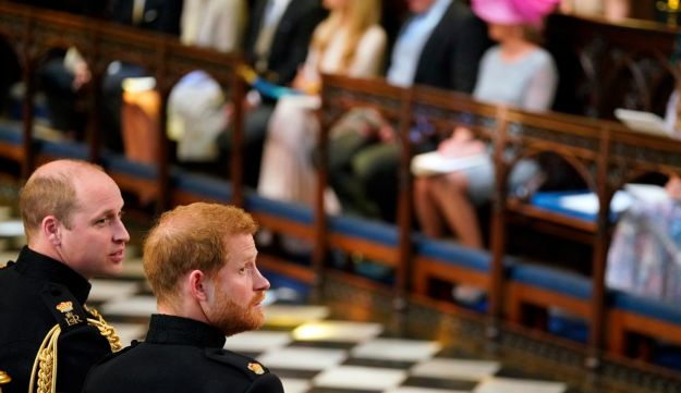 Britain's Prince Harry and brother Prince William during the wedding ceremony of Prince Harry and Meghan Markle at St. George's Chapel in Windsor Castle in Windsor, England on Saturday, May 19, 2018.