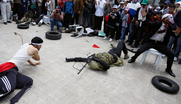 Pro-Palestinian protesters lie on the ground as they take part in a protest in Casablanca, May 2018.