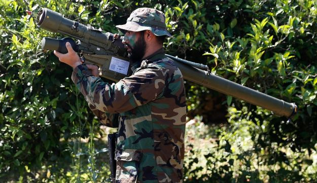 Hezbollah fighter holding an Iranian-made anti-aircraft missile on the border with Israel, in Naqoura, south Lebanon, April 20, 2017