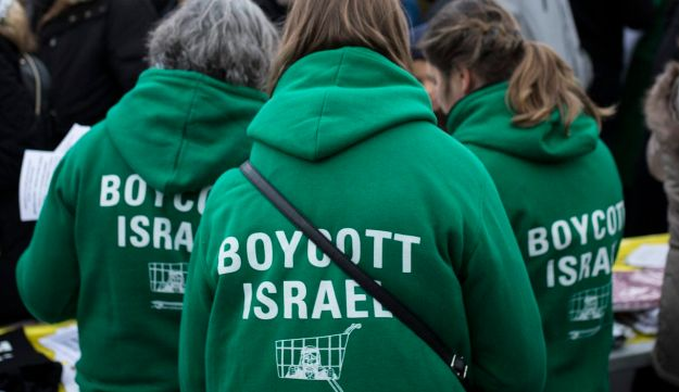 "FILE PHOTO: Demonstrators wear shirts reading ""Boycott Israel"" during a protest"
