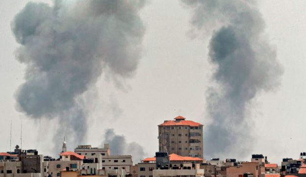 A picture taken from Gaza City on May 29, 2018, shows a smoke billowing in the background following an Israeli air strike on the Palestinian enclave.