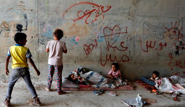 Palestinian Bedouin children play under a bridge near their village, Khan al-Ahmaron, which is under an Israeli demolition order despite appeals by EU governments. May 30, 2018