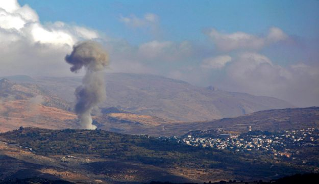 Smokes billows from the southern Syrian Druze village of Hadar on November 3, 2017 as seen from the Israeli-annexed Golan Heights.