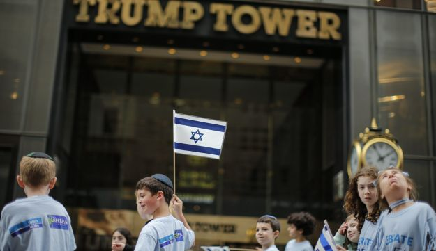 NEW YORK, NY - JUNE 03: People march in front of Trump Tower during the annual Celebrate Israel Parade on June 3, 2018 in New York City. Security will be tight for the parade which marks the 70th anniversary of the founding of Israel.   Kena Betancur/Getty Images/AFP