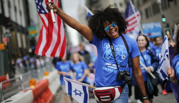 NEW YORK, NY - JUNE 03: People march during the annual Celebrate Israel Parade on June 3, 2018 in New York City. Security will be tight for the parade which marks the 70th anniversary of the founding of Israel.   Kena Betancur/Getty Images/AFP