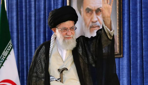 A handout picture provided by the office of Iran's Supreme Leader Ayatollah Ali Khamenei on June 4, 2018 shows him greeting the crowd during a ceremony on the occasion of the 29th anniversary of the death of the founder of the Islamic Republic, Ayatollah Ruhollah Khomeini at his mausoleum in a suburb of Tehran.