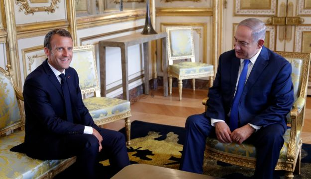 French President Emmanuel Macron, left, and Israel's Prime Minister Benjamin Netanyahu attend a meeting at the Elysee Palace, in Paris, June 5, 2018. Netanyahu is meeting France's President Macron as part of his European tour, in an effort to rally support from allies over Iran.