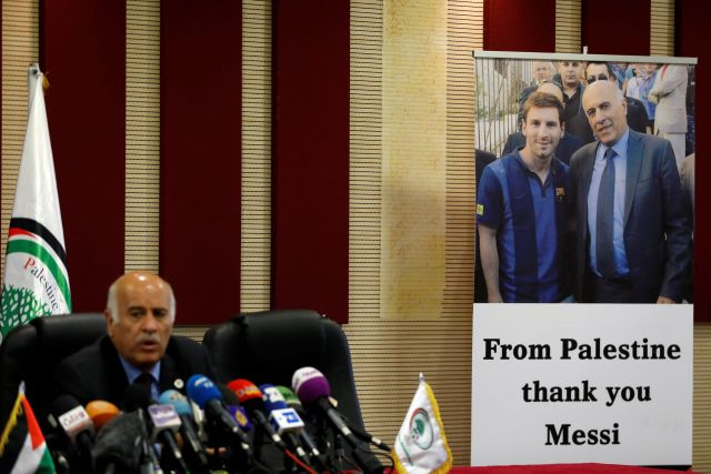 A poster of Palestinian FA chief Jibril Rajoub with Argentina's soccer player Lionel Messi, in Ramallah in the occupied West Bank June 6, 2018
