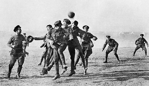 Soldiers taking part in an impromptu soccer match during a truce in World War I.