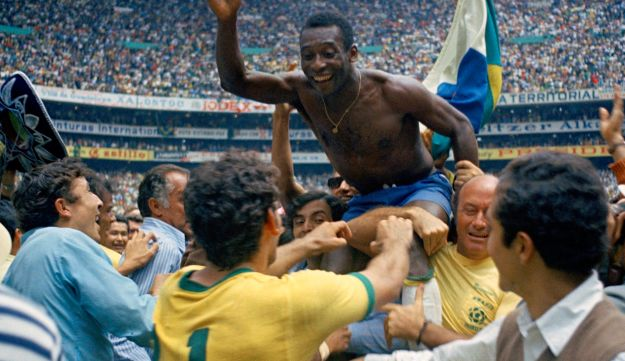 Brazil's Pele is hoisted on shoulders of his teammates after Brazil won the World Cup final against Italy, 4-1, in 1970.