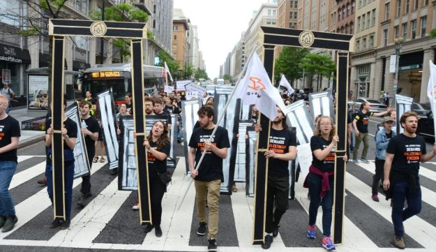 Members of IfNotNow and Rabbinical school students blocking traffic while protesting Trump's US Embassy move to Jerusalem, withdrawal from Iran Deal and Israeli violence against Palestinians in Gaza in Washington, D.C., May 14, 2018