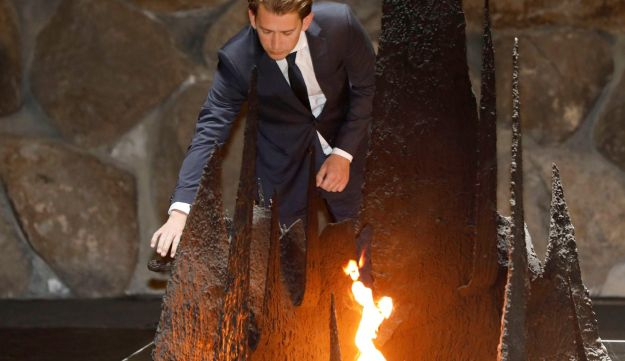 Austrian Chancellor Sebastian Kurz rekindles the eternal flame in the Hall of Remembrance at Yad Vashem World Holocaust Remembrance Center in Jerusalem. June 10, 2018.