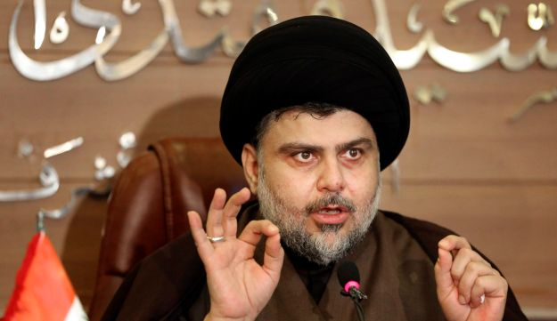 In this Dec. 29, 2015 file photo, Shiite cleric Muqtada al-Sadr speaks during a press conference in Najaf, 100 miles (160 kilometers) south of Baghdad, Iraq.