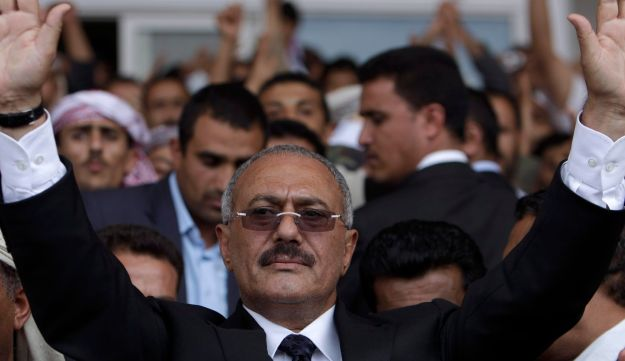 Yemen's then-President Ali Abdullah Saleh waves to his supporters during a rally in Sanaa, Yemen, April 15, 2011.