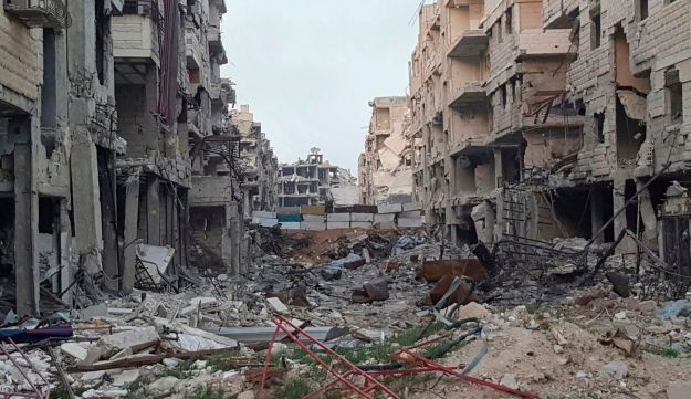 This March. 26, 2018 file photo, provided by Danny Makki, a British-born Syrian journalist, shows buildings damaged from fighting and Syrian government airstrikes in Harasta, eastern Ghouta, near Damascus, Syria. In a new report published Tuesday, May 29, 2018.