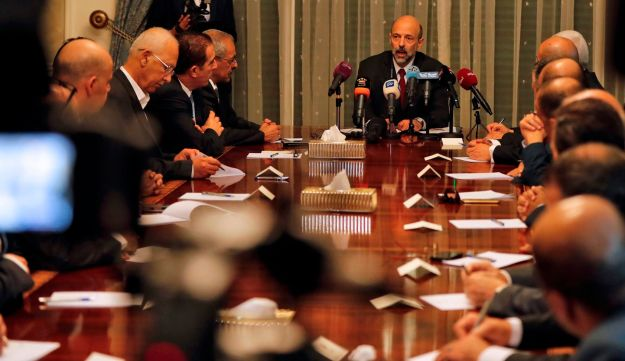 The newly appointed Jordanian Prime Minister Omar al-Razzaz (C) meets with member of Union leaders in Amman, on June 7, 2018.