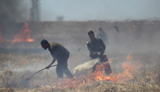Soldiers fight a fire in southern Israel on June 15, 2018.