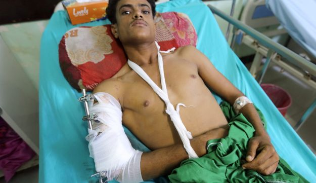 A man lies on a hospital bed, after he was inured by clashes between government forces and Houthi fighters near Hodeidah, Yemen June 15, 2018