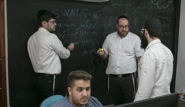 Shmuel Drilman, CEO and founder of the digital advertising firm Webetter, with employees.