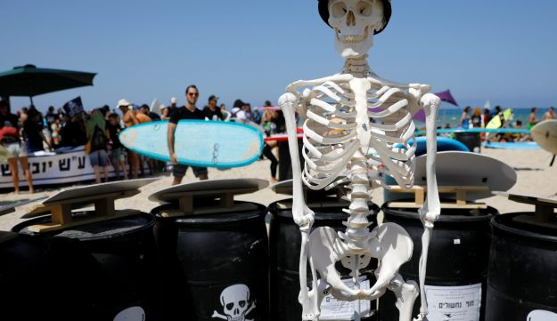 An installation on display as hundreds of Israeli surfers take part in what they said was a record-breaking protest against potential environmental damage in Herzliya.