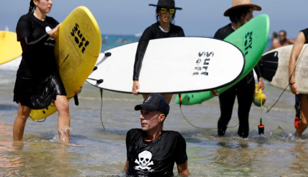 Israeli surfers protesting against the construction of a gas rig on the Mediterranean in Herzliya.