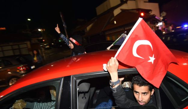 Turkish nationals, supporters of president Recep Tayyip Erdogan, currently residing in Bosnia and Herzegovina, cheer in downtown Sarajevo, late on June 24, 2018.