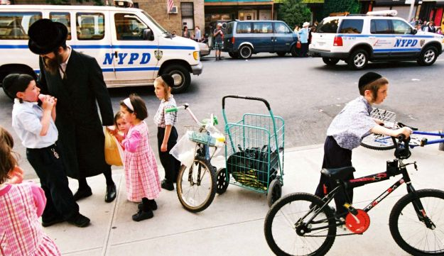 An ultra-Orthodox man and children in Borough Park, Brooklyn, New York in 2012. (Illustrative photo)