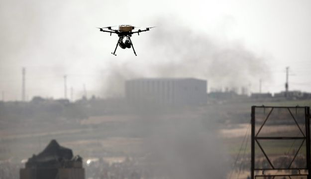 An Israeli drone is seen in action over the border between Israel and Gaza during a protest on the Gaza side, June 8, 2018.