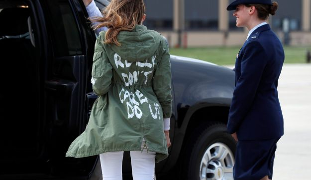 "U.S. first lady Melania Trump walks from her plane to her motorcade wearing a Zara design jacket with the phrase ""I Really Don't Care. Do U?"" June 21, 201"