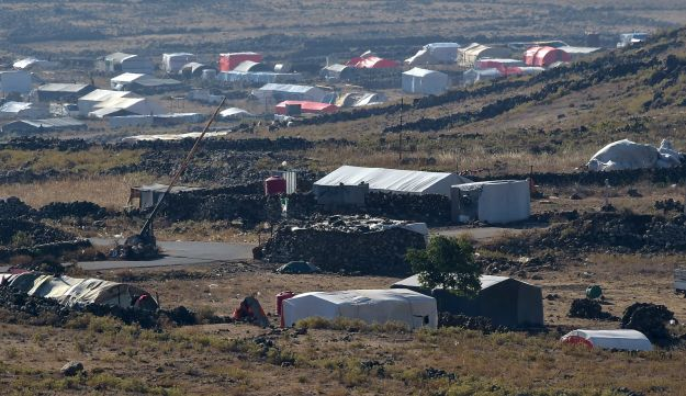 Makeshift encampments housing Syrians fleeing from Daraa, as seen from the Israeli side of the Golan Heights. June 29, 2018